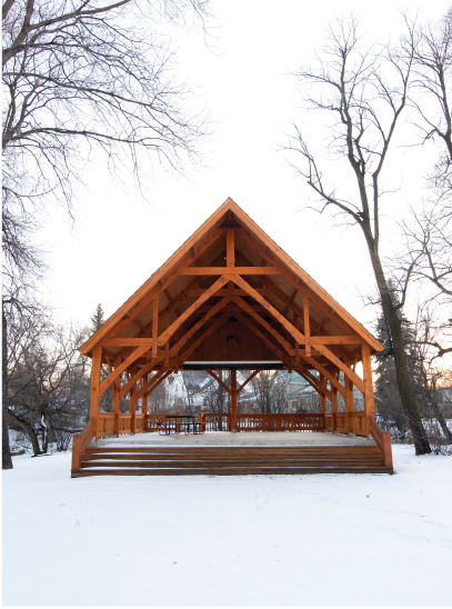 Image of a rural wooden gazebo with picnic tables for sale by Royal LePage Carman in Carman, MB