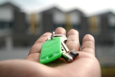 Person holding set of keys to newly bought house